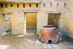 Herculaneum, ancient Roman town. wine warhouse with big amphora, Ercolano, Italy stock image