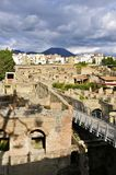 Herculaneum, Ercolano and Mount Vesuvius. Ancient Herculaneum and Modern day Ercolano. Portrait Mode. Herculaneum was buried in the eruption of Mount Vesuvius in Royalty Free Stock Photo