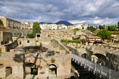 Herculaneum, Ercolano and Mount Vesuvius. Ancient Herculaneum and Modern day Ercolano. Herculaneum was buried in the eruption of Mount Vesuvius in AD 79. Unlike Royalty Free Stock Images