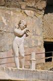 Herculaneum Terrace, Campania, Italy. Small statue on the Herculaneum Terrace, in portrait mode Stock Photos