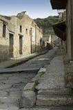 Herculanum excavations 2. Street of Herculanum with houses and detail of Herculaneum Excavations. Ruins from the vulcano eruption, Naples, Italy Royalty Free Stock Photography