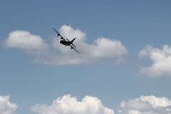 Hercules C130. The silhouette of a C130 Hercules military transport plane against a cloudy sky Stock Photography