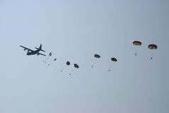 Hercules drops parachutes 3 Royalty Free Stock Photography