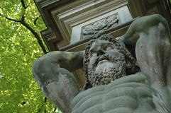 Hercules statue. A statue of Hercules, one of many characters from Greek mythology. Here he is holding up the pillars at the entrance of a public park Royalty Free Stock Photography