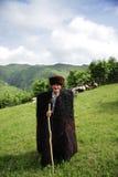 Herdsman in mountains Stock Photos
