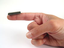 Here it is :-). Electronic chip on finger Royalty Free Stock Photos