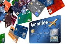 Here is an air rewards credit card with airline credit cards floating in the air. stock illustration