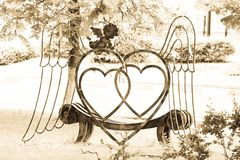 Bench for lovers in the city Park of ancient Polotsk. Here angel wings are opened and two loving hearts beat in unison. Do I feel like this was all with me? Royalty Free Stock Photos