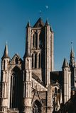 Ghent architecture and the moon at the sky stock image