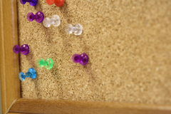 Here is a close up of multi colored color colorful push pins thumb tacks. Royalty Free Stock Images