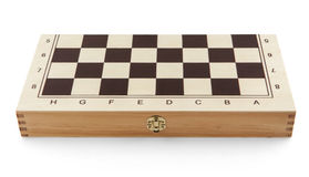 Here are closed chess box - isolated on white Royalty Free Stock Photo