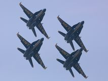 Here Come The Blue Angels. Blue Angels Rolling Climb, Front Underside View Royalty Free Stock Image