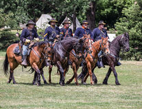 Here Comes the Cavalry. Civil War era soldiers in battle at the Dog Island reenactment in Red Bluff, California royalty free stock photography
