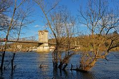 Here comes the flood on Saone river. LYON, FRANCE, March 10, 2018 : Flood of Saone river in Couzon Royalty Free Stock Photo