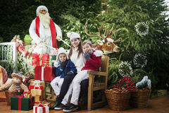 Here comes Santa Claus, family surprise Stock Photo