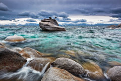 Here Comes the Storm, Lake Tahoe. Bonsai Rock in Sand Harbor, Lake Tahoe stands firm in a spring storm Stock Photo