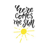 Here comes the sun - hand drawn lettering quote isolated on the white background. Fun brush ink inscription for photo vector illustration