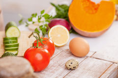 Here is everything what you really need. Close up of healthy fruits, vegetables and eggs on the table Royalty Free Stock Images