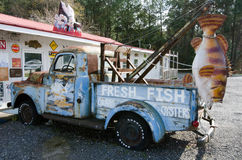 Here Fishy, Here Fishy !. A vintage 1954 dodge pickup tow truck displays a fish from the tow bar and various painted seafood signs along Highway 17 in Litchfield Stock Photos