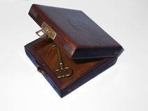 Here is the key. Key in a wooden box royalty free stock photo