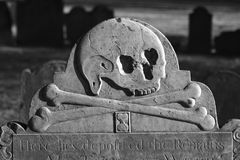 Here lies deposited the remains. Detail of old head stone in the granary burial ground in boston massachusetts dating back to 1660, here we see a skull with Royalty Free Stock Photos