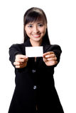 Here is my card. Young pretty successful asian female executive with a white card Royalty Free Stock Photography