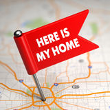 Here Is My Home - Small Flag on a Map Background. Royalty Free Stock Images