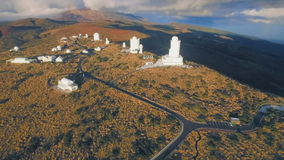 Here observe the cosmos and the stars - astronomical observatory. Aerial Shot of astronomical observatory on Mount Teide Tenerife Spain stock video footage