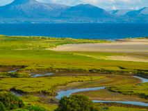 Meandering river, Atlantic Ocean and Mountains royalty free stock photo
