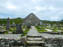 St. Dympna`s 18th century Church, with grave stones. Here is a photograph of the 18th century St. Dympna`s Church. Also in the photo is the very old grave stones stock photography