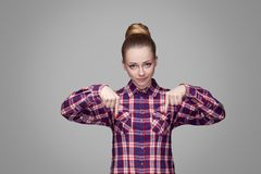 Here and right now. serious angry blonde girl in red, pink check royalty free stock images