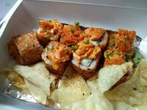 Japanese spicy rolls in a box. Here& x27;s a pic of some Japanese rolls. It& x27;s spicy. And it has some crunchy stuff too but I don& x27;t think it& x27;s royalty free stock photos
