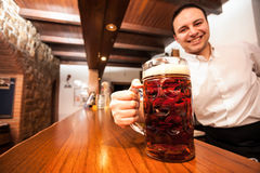 Here's your beer Royalty Free Stock Photography
