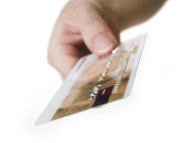 Here's your card. Person holding a credit card, isolated on white background stock photography