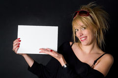 Here's your message. Girl presenting an empty piece of paper, ready to place your message or your ad on Royalty Free Stock Photo