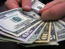Here's your money!. Fan of bills in hand Royalty Free Stock Images