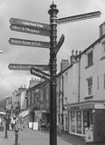 Here there and everywhere. Village sign in Yorkshire Royalty Free Stock Photo