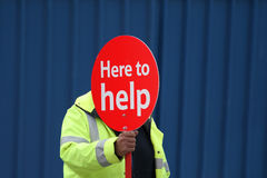 Here to help. Man holding help sign, covering his face royalty free stock images