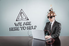 We are here to help text with vintage businessman using laptop Stock Image