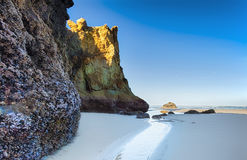 Arcadia Beach Oregon Coast. Here a watery path leads the eye past huge rock formations to the surf beyond.; One of several meditative places on Arcadia; on the Royalty Free Stock Photography