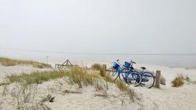 Trip through sand dunes on bicycles in Klaipeda royalty free stock photo