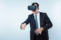 Office employee playing virtual reality games Stock Photo
