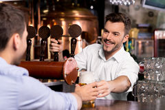 Here is your beer. stock photography