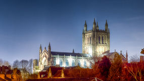 Hereford Cathedral by night above rooftops and trees Stock Images