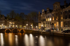 Herengracht in Amsterdam. Night shot of the corner Herengracht and Leidsegracht in Amsterdam, Netherlands in spring Stock Photos