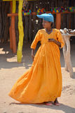 Herero Woman. KAOKOLAND NAMIBIA OCTOBER 14: Unidentified Herero Woman in traditional clothes on oct. 14, 2014 near Opuwo. Namibia. The Herero belonging to the Stock Images