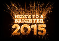 Heres To A Brighter 2015 greeting on dark background. Royalty Free Stock Photos