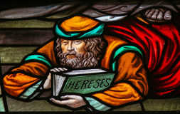 Heretic - Stained Glass in Mechelen Cathedral Royalty Free Stock Images