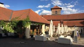 Hergetova cihelna. Prague, Czech Republic - 24 April, 2018: Hergetova cihelna. Elegant restaurant spread over several rooms and terraces and featuring stock video footage