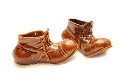Herinnering - ceramische Schoenen op een witte achtergrond Royalty-vrije Stock Fotografie